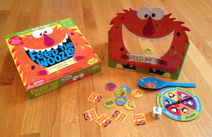 Feed the Woozle game with the pieces all laying out and the monster upright in the back.