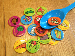 Blue spoon with Feed the Woozle gross tokens