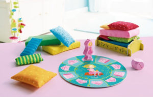 sleepy princess pile up game showing the different color and size cushions and the princess on the circular board